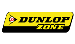 The logo for Dunlop Zone with a yellow and black background